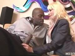 Dude catches his sexy busty personal assistant jerking big black dick.