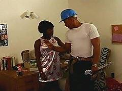 Cute black girl Meka Johnson works at her desk in her dorm when she\'s joined by a construction worker looking to renovate. She decides that she needs more space, so she kneels in front of him to suck his hard black cock. She blows him while he pulls her dress up to feel her round ass. She lays back as he eats out her hairy pussy, and she stands and bends over so he can fuck her doggy style. She climbs on top to ride him reverse cowgirl, and he slides his dick into her tight asshole. After reaming her anal, he blows his load all over her pert natural tits.