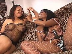 Ebony babes Persuajon and Beauty Dior get zoned with a little ganga while Beauty is wearing a big black strap on dildo and a fishnet body suit. Persuajon gets horny and starts to dance, shaking her ass for the camera. Beauty eagerly gets her hands all over Persuajon\'s thick body, scooping up her tits to suckle her nipples. Getting naked from the waist down Persuajon sits on Beauty\'s waist and slowly eases her strap on into her tight hole bouncing up and down on the big black dick. Beauty drills Persuajon hard and fast, making her moan as she cums.