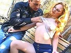 A perverted prematurely balding man approaches a beautiful young blond with surprisingly large breasts in the park.  As he sits down next to her on the bench, he can\'t take his eyes off her slim thighs, completely bare and barely covered by her tiny skirt.  Edging closer to her on the bench, he puts one arm around her shoulders, reaching forward with the other to touch her panties.  He feels that she is moist and that she is completely bald underneath the fabric of her underwear.  He leads the gullible young babe home, getting her sucking on his throbbing cock before he nails her, driving his penis deep inside her tender coed vagina.