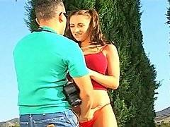 If you owned a Lamborghini like stud Brett Rockman, you too could score gorgeous young sluts like Kodey Coxxx!  Brett is polishing his car in the driveway when the busty young tart walks up to him, obviously awestruck by the attractive young guy with the nice ride.  She is wearing a low-cut red top that shows off her large breasts and skintight jeans.  Soon Brett has her jeans down around her ankles while he fingers her pussy.  Then he bends her over the trunk of his car, pulling her panties down and slamming his prick into her slippery hole.  As he fucks her roughly doggy style, she groans and hopes that he will make her his girlfriend.