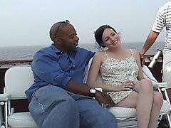 They find Terrill hanging out in a parking lot and offer her money to join them on their boat. Once on the boat they enjoy the view on the water before enjoying the view of her exposed firm tits and sweet twat. She knees in front of Shane and whips out his thick black dick so she can get her hands all over it and suck on his head. With her ass in the air another black boner penetrates her hole and rams her from behind. After taking turn fucking her doggy style, she straddles Shane and rides his hard shaft like a cowgirl. He takes her from behind again then lays her back and pushes her knees to her chest before cumming on her face.