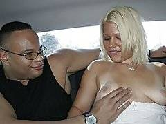 A bored and burly Sledge Hammer drives around looking for a little action.  He spots sexy blonde Heather Huntley as she walks down the street, and she agrees to join him for a ride.  They get a bit naughty in the car, and she joins him back at his place.  He soon as her naked, and he eats out her bald pussy.  She pays him back by sucking his huge cock, and she climbs on top to ride him cowgirl.  He lays her back to fuck her missionary, and she gets on her hands and knees to take it doggy-style.  He finally gives her a messy facial.