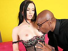 Sometimes you see a tiny white pussy that is just too little for a big black cock!  Stunning brunette babe Ally Style might have an enormous pair of natural tits, but her pussy is tiny and bald.  She quails visibly when she lays eyes on the enormous black member of ebony stud Sean Michaels; this guy is extremely well hung, with a long, thick cock that is rock hard.  Ally gapes at the penis as Sean slides it into her little fuckhole, stretching her out good.  She starts to moan loudly, especially when she gets on top and grinds on the penis.  As Sean starts to hammer her in doggystyle, Ally really starts to cum on the cock!