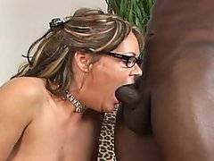 When dreadlocked black stud Byron Long walks into the room, he's shocked to see his girl, filthy cheating white housewife Kelly Leigh, standing there in her panties, stockings and suspenders.  This blond babe looks ready to eat!  He thrusts his big black cock in to Kelly's mouth and then bends her over for a hardcore pussy pounding.  Not content with this hardcore penetration, he spits on her ass hole, manfully shoving her face down into the mattress while he fucks her up the butt.  Kelly squeals in a mix of pain and pleasure - she loves being dominated by a virile ebony stud like Byron!  He creams mightily into the distraught babe's mouth.