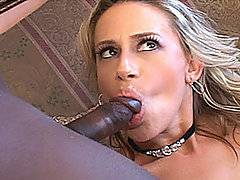 This excellent interracial video begins with big titty blond MILF Kylie masturbating on the sofa.  You can tell by her jewelery and the plush surroundings that this babe is rich - but like a lot of wealthy women, she loves to slum it with hung black studs with big cocks!  Just as she is beginning to finger herself in earnest, ebony stud D Wise enters the video, feeding her his big black cock.  Kylie is ecstatic - it's exactly what she craves!  She takes it hard in missionary and doggy, taking the filthy black penis back in her mouth to swallow the whole load.  Some of it dribbles out the side of her mouth and onto her full breasts.