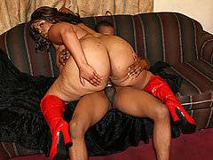 Vicki Nicole has absolutely massive tits, even when compared to other BBW women. This black bbw amateur loves to push them right in the camera, wearing nothing but a pair of red high heel boots. She loves working her body up and down, going past her folds, loving the way her hefty body looks. Dwayne Cummings loves that too, and he ends up sinking his dick deep inside her delicious ass. She spreads herself out nice and wide, letting his thick dick dive again and again in between her thick booty. She just loves this!
