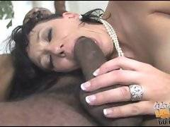 Busty mature slutie licks and sucks big black cock before jumping on it.