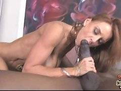 Breasted redhead milf jumps on massive black meat and licks off her own pussy juices from it.