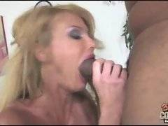Tough black dude slams his big cock in blonde's mouth and drills her wet sluty pussy on table.