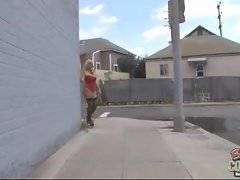Shapely blonde in underwear walks alonge the street and catches car.