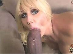 Milf sucks such a huge black dick she can only swallow glanse.