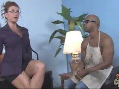 Muscled black man is working for severe white lady.