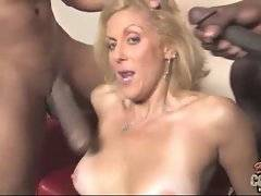 Blonde milf is doing blowjob for one stiffened cock