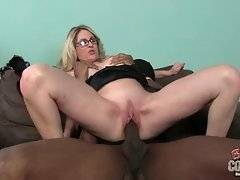 Big boobed blonde ladyboss is jumping on her sub`s big black cock.