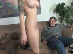 This adorable slut is playing with huge dicks