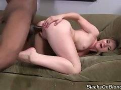 Pretty white chick gets her pussy pocked with black dick.
