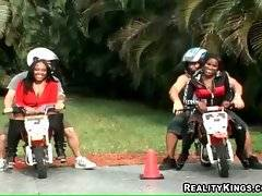 These naughty ebony chicks are fond of motorcycles.