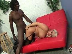 Nasty mature blonde is fond of deep anal massage.