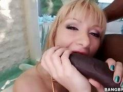 Awesome blondie eagerly blows big black cock.