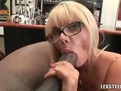 Blonde kneels down and opens her mouth for black rod.