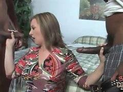 Milf readily handles two erect black cocks.