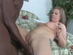 This sluty mom is fond of stiff big black cocks.