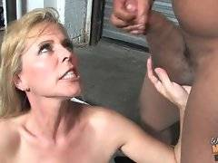 Blonde lady opens her mouth to catch cumshot.