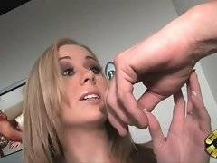 Naughty blondie undresses and starts to suck thick cock in glory hole.
