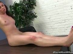Casey Calvert massages her black partner`s erect boner with her feet.