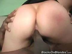 Big boobed blond milf greatly enjoys thick black dong.