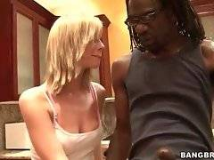 Awesome blonde frees friend`s big black dick and swallows it.