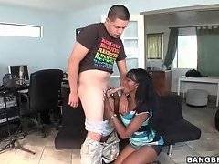 Attractive black slutie kneels down and tastes juicy white dick.