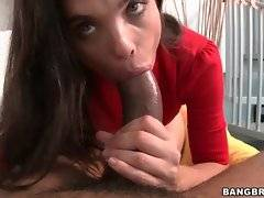 Sexy brunette passionately works her mouth at enormous black dick.