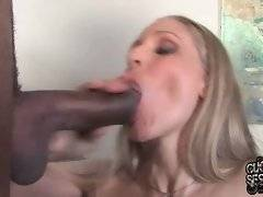 Awesome big boobed mature blonde hungrily sucks two huge black dicks.
