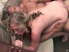 White babe gets her mouth and pussy filled with big black cocks.