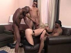 Three muscled black dudes are sharing curvaceous white milf.