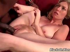 Horny black stud shoves his large dong into white babe`s hole.