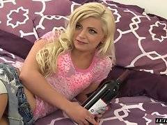 This blonde beauty is waiting on her bed for her man to show up and fuck her. Finally he does and she gets right into sucking his hard cock. She then takes her sexy pink top and short shorts off and spreads her legs so she can gets her pussy ate out.